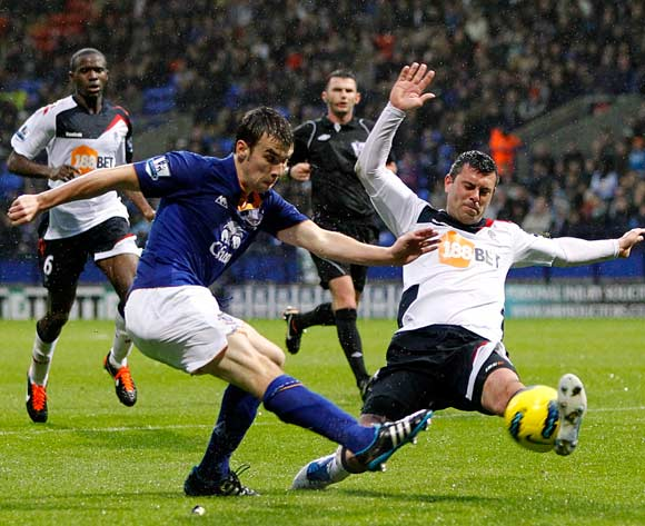 Bolton Wanderers' Paul Robinson (right) blocks an attempt on goal by Everton's Seamus Coleman (left)