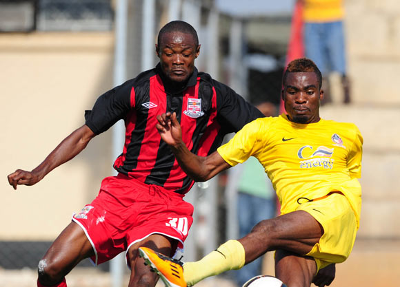 Luka Lungu of Power Dynamos challenges Kunda Mushota of Zanaco