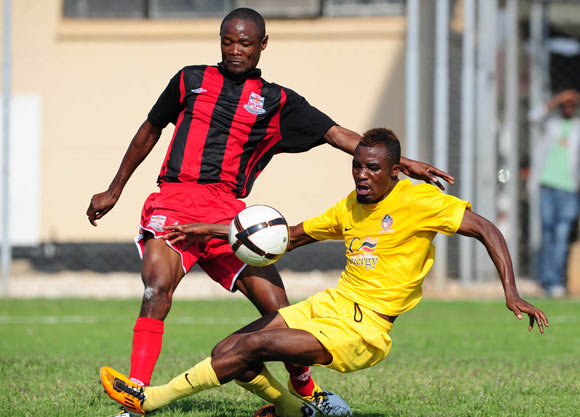 Kunda Mushota of Zanaco tackles Luka Lungu of Power Dynamos
