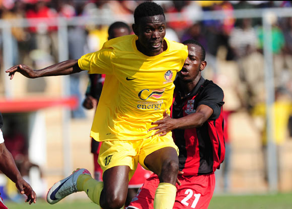 Joseph Sitali of Power Dynamos evades challenge from Boyd Mwangelwa of Zanaco