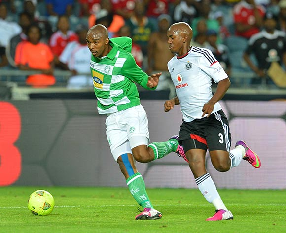 Lennox Bacela of Bloemfontein Celtic evades challenge from Patrick Phungwayo of Orlando Pirates during the Absa Premiership 2012/13 match between Orlando Pirates and Bloemfontein Celtic at Orlando Stadium, Soweto, South Africa on 6 March 2013