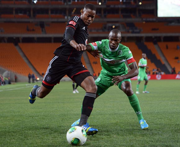 Happy Jele of Orlando Pirates shields the ball away from Letladi Madubanya of AmaZulu during the Absa Premiership match between Orlando Pirates and AmaZulu on the 08 August 2013 at FNB Stadium