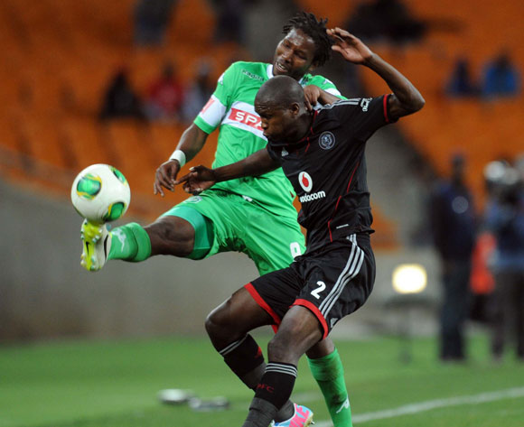 Ayanda Gcaba of Orlando Pirates is challenged by  Bongani Ndulula of AmaZulu during the Absa Premiership match between Orlando Pirates and AmaZulu on the 08 August 2013 at FNB Stadium