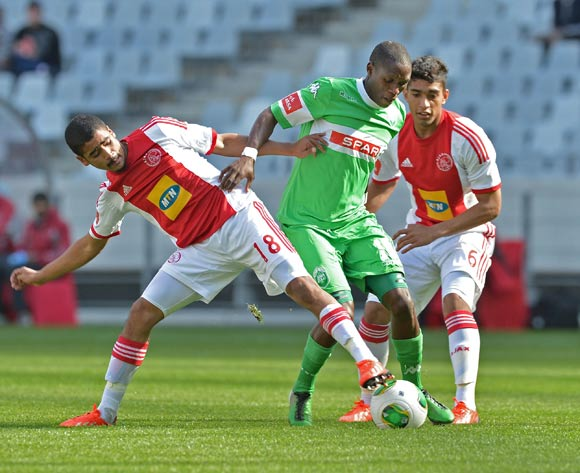 Njabulo Manqana of AmaZulu tackled by Abbubaker Mobara of Ajax Cape Town and Travis Graham of Ajax Cape Town during the Absa Premiership 2013/14 football match between between Ajax Cape Town and AmaZulu at Cape Town Stadium, Cape Town on 1 September 2013