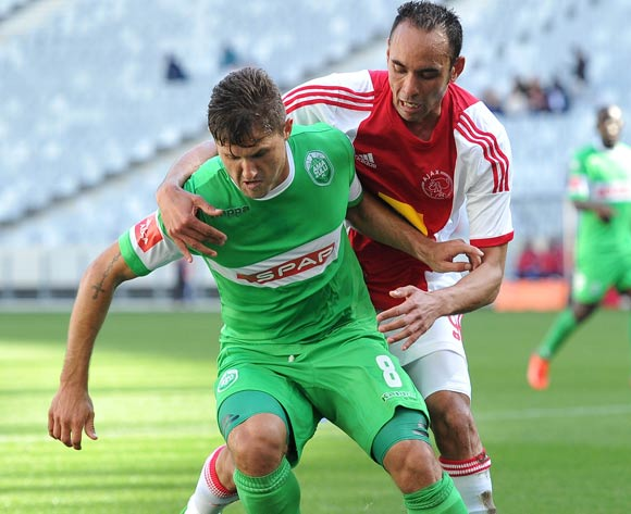 Eleazar Rodgers of Ajax Cape Town battles for the ball with Marc Van Heerden of AmaZulu during the Absa Premiership 2013/14 football match between between Ajax Cape Town and AmaZulu at Cape Town Stadium, Cape Town on 1 September 2013 ©Chris Ricco/Backpage