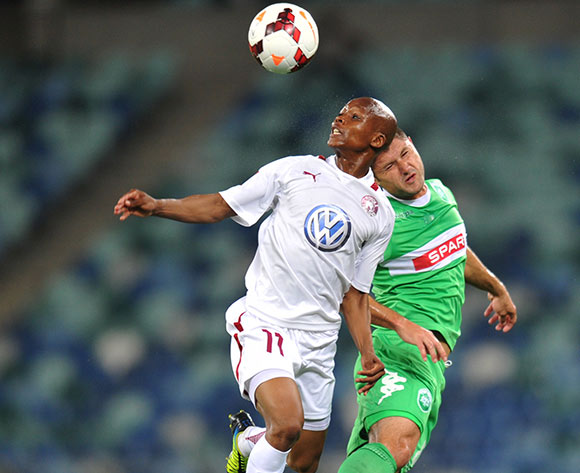 Dikgang Mabalane of Moroka Swallows battles Marc van Heerden of AmaZulu during the Absa Premiership 2013/14 Football match between AmaZulu and Moroka Swallows at the Moses Mabhida Stadium , Durban on the 14th of September 2013