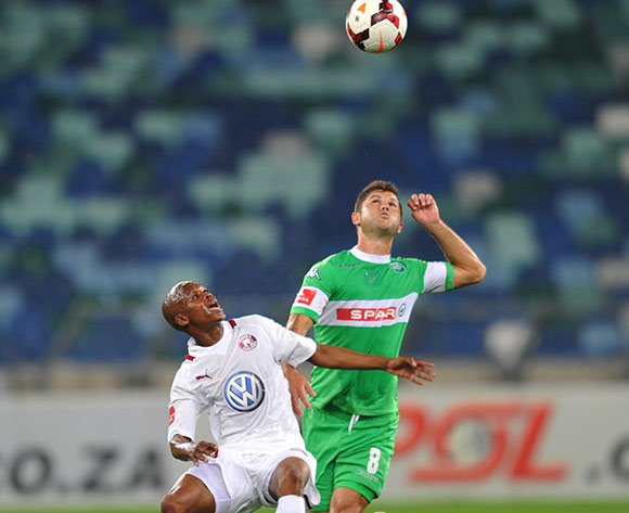 Marc van Heerden of AmaZulu battles Dikgang Mabalane of Moroka Swallows during the Absa Premiership 2013/14 Football match between AmaZulu and Moroka Swallows at the Moses Mabhida Stadium , Durban on the 14th of September 2013