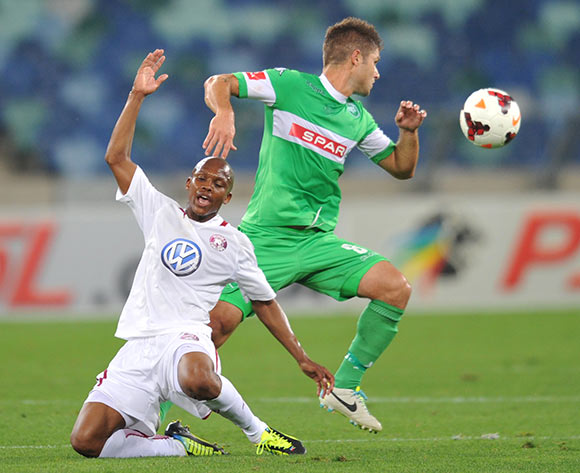 Dikgang Mabalane of Moroka Swallows and Marc van Heerden of AmaZulu during the Absa Premiership 2013/14 Football match between AmaZulu and Moroka Swallows at the Moses Mabhida Stadium , Durban on the 14th of September 2013