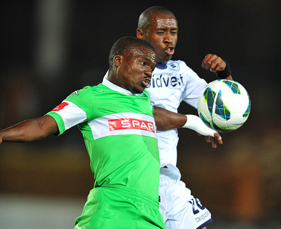 Goodman Dlamini of Amazulu battle with Siyabonga Nhlapho of Bidvest Wits during the Absa Premiership football match between Bidvest Wits and Amazulu at the Bidvest Stadium, Johannesburg on 17 September 2013