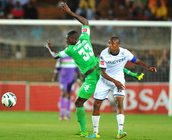 Carlington Nyadombo of Amazulu challenged by Sibusiso Vilakazi of Bidvest Wits during the Absa Premiership football match between Bidvest Wits and Amazulu at the Bidvest Stadium, Johannesburg on 17 September 2013