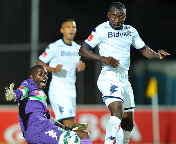 Kapini Tapuwa of Amazulu tackled by Kofi Dankwae of Bidvest Wits during the Absa Premiership football match between Bidvest Wits and Amazulu at the Bidvest Stadium, Johannesburg on 17 September 2013