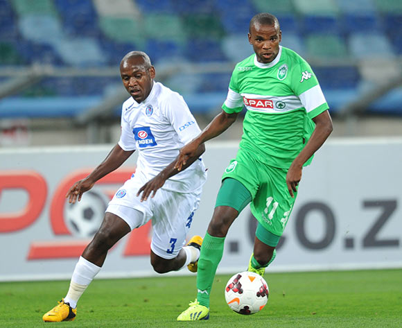 Ayanda Dlamini of AmaZulu and Sibusiso Khumalo of Supersport United during the Absa Premiership 2013/14 Football match between AmaZulu and Supersport United at the Moses Mabhida Stadium , Durban on the 21st of September 2013