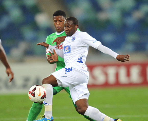 George Maluleka of Supersport United and Kulegani Madondo of AmaZulu during the Absa Premiership 2013/14 Football match between AmaZulu and Supersport United at the Moses Mabhida Stadium , Durban on the 21st of September 201