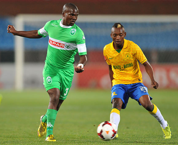 Goodman Dlamini of Amazulu challenged by Khama Billiat of mamelodi Sundowns during the Absa Premiership football match between Mamelodi Sundowns and Amazulu at the Loftus Stadium, Pretoria on 22 October 2013