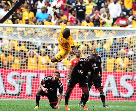 Bernard Parker of Kaizer Chiefs  heads ball clear from Sifiso Myeni of Orlando Pirates during the 2013/14 Absa Premiership football match  between Kaizer Chiefs and Orlando Pirates at Soccer City, Johannesburg on the 26 October 2013