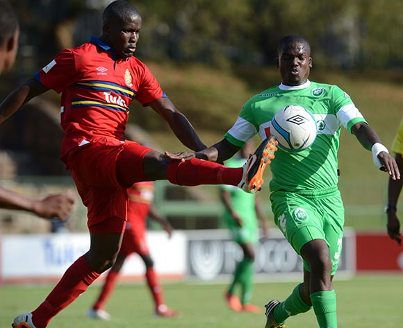 Ronald Ketjijere of University of Pretoria battles with Goodman Dlamini of AmaZulu during the Absa Premiership match between University of Pretoria and AmaZulu on the 30 November 2013 at Tuks Stadium