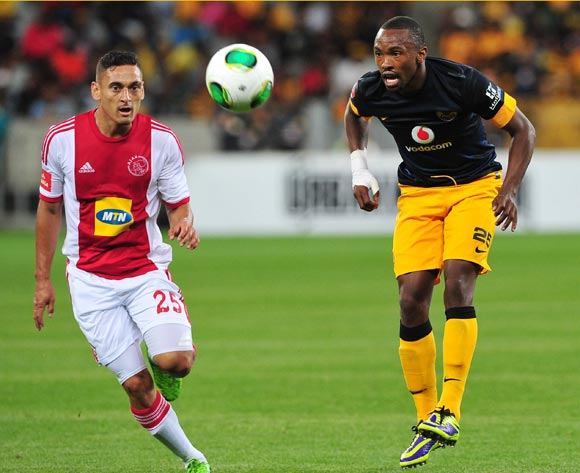 Bernard Parker of Kaizer Chiefs chips the ball through as Cole Alexander of Ajax Cape Town closes in during the Absa Premiership 2013/14 football match between Ajax Cape Town and Kaizer Chiefs at Cape Town Stadium, Cape Town on 5 November 2013 ©Ryan Wilki