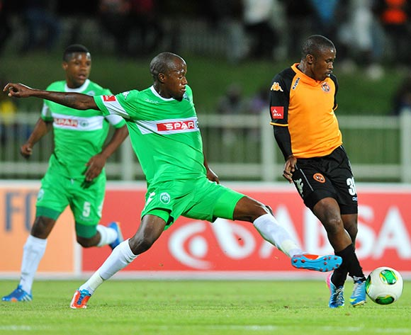 Luyanda Hlongwa of Polokwane City challenged by Sifiso Hlanti of Amazulu during the Absa Premiership football match between Polokwane City and Amazulu at the Old Peter Mokaba Stadium, Limpopo on 06 November 2013