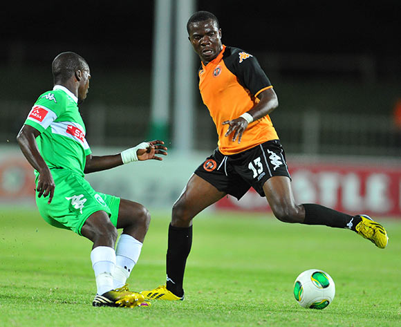 Galabgwe Moyana Polokwane City challenged by Goodman Dlamini of Amazulu during the Absa Premiership football match between Polokwane City and Amazulu at the Old Peter Mokaba Stadium, Limpopo on 06 November 2013