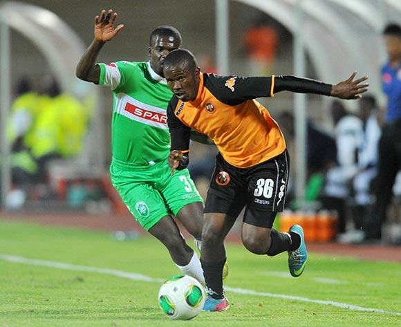 Luyanda Hlongwa of Polokwane City challenged by Goodman Dlamini of Amazulu during the Absa Premiership football match between Polokwane City and Amazulu at the Old Peter Mokaba Stadium, Limpopo on 06 November 2013