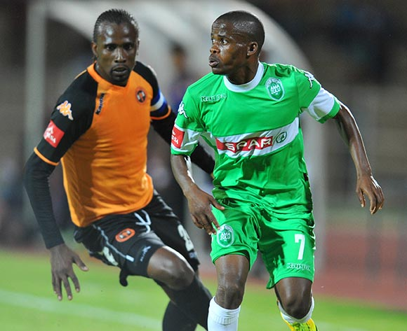 Nkhosinathi Mthiyane of Amazulu challenged by Thapelo Tshilo of Polokwane City during the Absa Premiership football match between Polokwane City and Amazulu at the Old Peter Mokaba Stadium, Limpopo on 06 November 2013