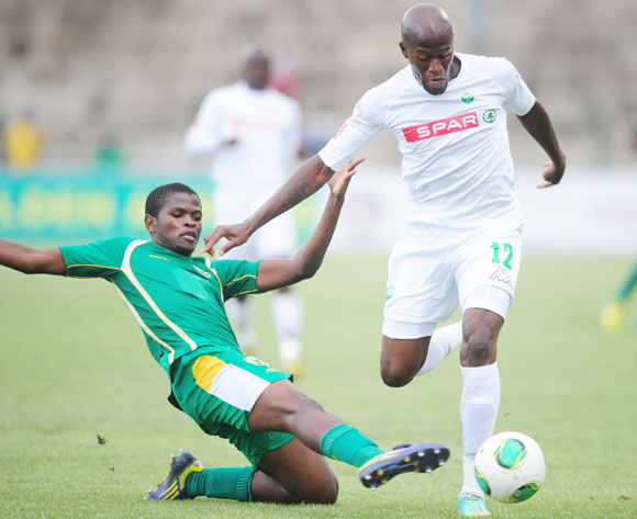Nkanyiso Mngwengwe of Golden Arrows battles Sifiso Hlanti of AmaZulu during the Absa Premiership 2013/14 football match between Golden Arrows and AmaZulu at the King Zwelithini Stadium in Durban, Kwa-Zulu Natal on the 16th of December 2013