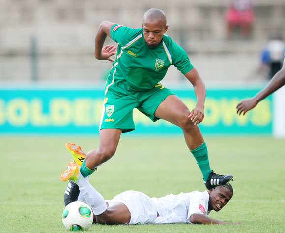 Lebongang Mothibantwa of Golden Arrows battles Nkhosinathi Mthiyane of AmaZulu during the Absa Premiership 2013/14 football match between Golden Arrows and AmaZulu at the King Zwelithini Stadium in Durban, Kwa-Zulu Natal on the 16th of December 2013