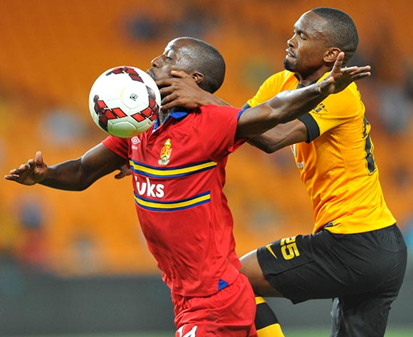Mpho Maruping of University of Pretoria challenged by Bernard Parker of Kaizer Chiefs during the Absa Premiership football match between Kaizer Chiefs and University of Pretoria at the FNB Stadium, Johannesburg on 16 December 2013