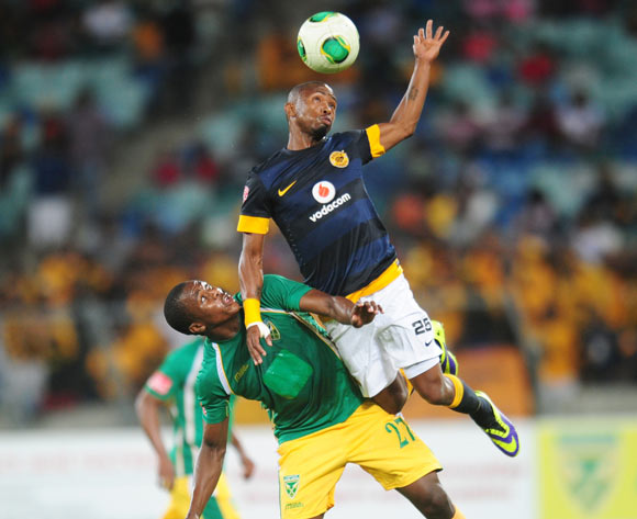 Bernard Parker of Kaizer Chiefs  battles Bonginkosi Ntuli of Golden Arrows during the Absa Premiership 2013/14 football match between Golden Arrows and Kaizer Chiefs at the Moses Mabhida Stadium in Durban, Kwa-Zulu Natal on the 19th of December 2013