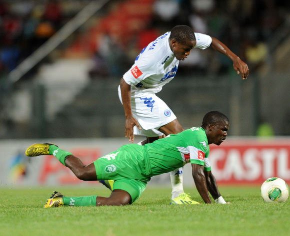 Goodman Dlamini of Amazulu challenged by Lebohang Manyama of Supersport United during the Absa Premiership football match between Supersport United and Amazulu at the Lucas Moripe Stadium, Pretoria on 28 January 2014