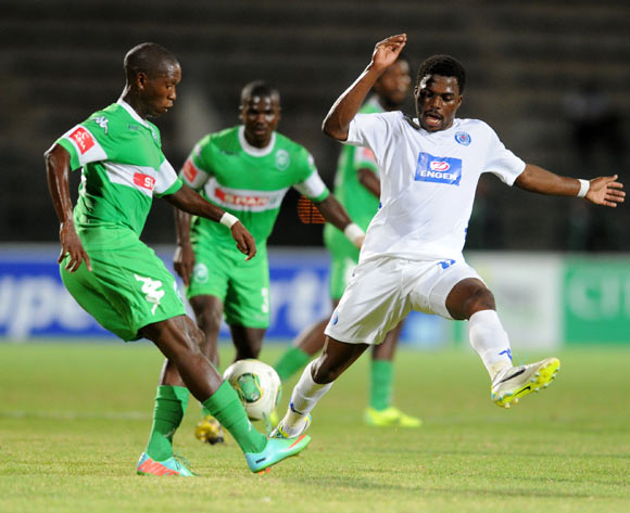 Njabulo Manqana of Amazulu challenged by Enocent Mkhabela of Supersport United during the Absa Premiership football match between Supersport United and Amazulu at the Lucas Moripe Stadium, Pretoria on 28 January 2014