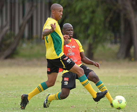 Hlompho Kekana evades challenge from Thabo Nthethe of South Africa during the 2014 CAF African Nations Championships South Africa Training Session at Lansdowne, Cape Town on 5 January 2014