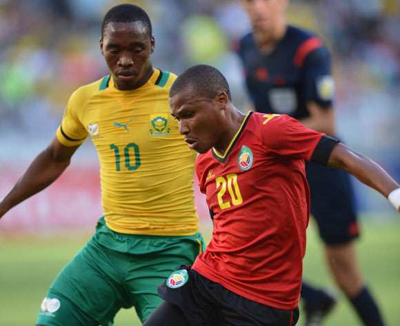Josemar Machaisse of Mozambique gets away from Sibusiso Vilakazi of South Africa during the 2014 CAF African Nations Championships Group A football match between South Africa and Mozambique at Cape Town Stadium, Cape Town on 11 January 2014