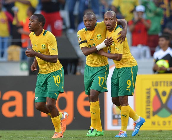 Bernard Parker of South Africa celebrates his goal with his teammates Katlego Mashego during the 2014 CAF African Nations Championships Group A football match between South Africa and Mozambique at Cape Town Stadium, Cape Town on 11 January 2014