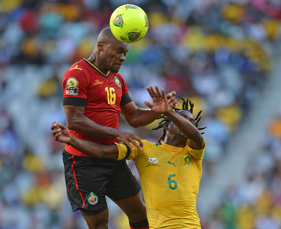 Almiro Lobo of Mozambique battles for the ball with Lerato Chabangu of South Africa during the 2014 CAF African Nations Championships Group A football match between South Africa and Mozambique at Cape Town Stadium, Cape Town on 11 January 2014