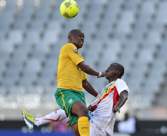 Hlompho Kekana of South Africa battles for the ball with Ibourahima Sidibe of Mali during the 2014 CAF African Nations Championships Group A football match between South Africa and Mali at Cape Town Stadium, Cape Town on 15 January 2014