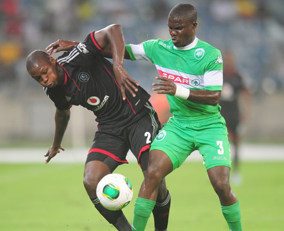 Goodman Dlamini of AmaZulu battles Ayanda Gcaba of Orlando Pirates  during the Absa Premiership 2013/14 football match between AmaZulu and Orlando Pirates at the Moses Mabhida Stadium in Durban, Kwa-Zulu Natal on the 23rd of January 2014