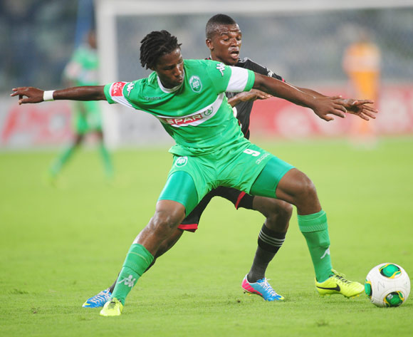 Bongani Ndulula AmaZulu battles Khethowakhe Masuku of Orlando Pirates during the Absa Premiership 2013/14 football match between AmaZulu and Orlando Pirates at the Moses Mabhida Stadium in Durban, Kwa-Zulu Natal on the 23rd of January 2014
