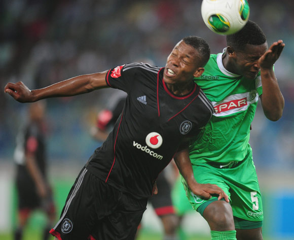 Khulegani Madondo of AmaZulu battles Happy Jele of Orlando Pirates during the Absa Premiership 2013/14 football match between AmaZulu and Orlando Pirates at the Moses Mabhida Stadium in Durban, Kwa-Zulu Natal on the 23rd of January 2014