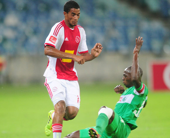 Tashreeq Morris of Ajax Cape Town tackled by Goodman Dlamini of AmaZulu during the Absa Premiership 2013/14 football match between AmaZulu and Ajax Cape Town at the Moses Mabhida Stadium in Durban, Kwa-Zulu Natal on the 4th of February 2014