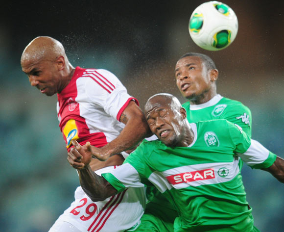 Nathan Paulse of Ajax Cape Town challenged by Sifiso Hlanti of AmaZulu during the Absa Premiership 2013/14 football match between AmaZulu and Ajax Cape Town at the Moses Mabhida Stadium in Durban, Kwa-Zulu Natal on the 4th of February 2014