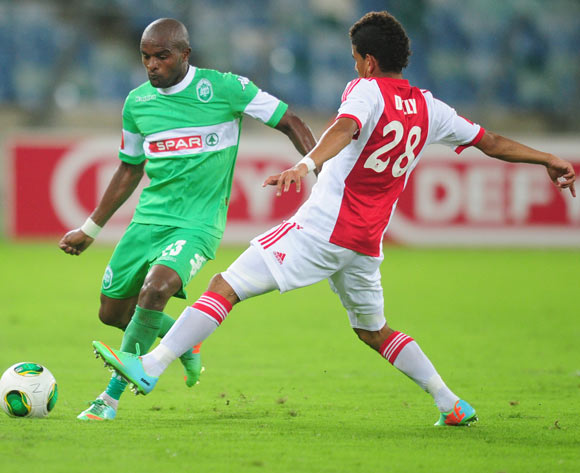 Bonginkosi Macala of AmaZulu and Keagan Dolly of Ajax Cape Town during the Absa Premiership 2013/14 football match between AmaZulu and Ajax Cape Town at the Moses Mabhida Stadium in Durban, Kwa-Zulu Natal on the 4th of February 2014