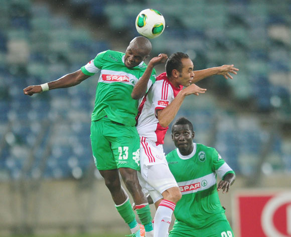 Bonginkosi Macala of AmaZulu and Eleazar Rodgers of Ajax Cape Town during the Absa Premiership 2013/14 football match between AmaZulu and Ajax Cape Town at the Moses Mabhida Stadium in Durban, Kwa-Zulu Natal on the 4th of February 2014