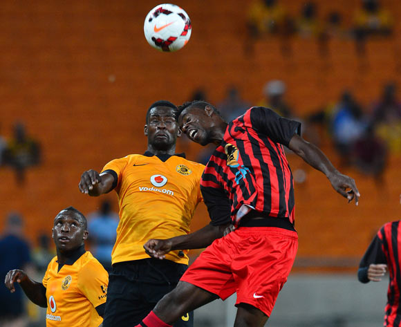 Roger Katjateo of Black Africa battles for the ball with Kgotso Moleko of Kaizer Chiefs during the 2014 CAF Champions League Football Match between Kaizer Chiefs and Black Africa at FNB Stadium on 8 February 2014