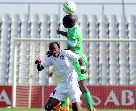 Goodman Dlamini of AmaZulu battles with Asavela Mbekile of Moroka Swallows  during the Absa Premiership match between Moroka Swallows and AmaZulu on the 08 February 2014 at Dobsonville Stadium