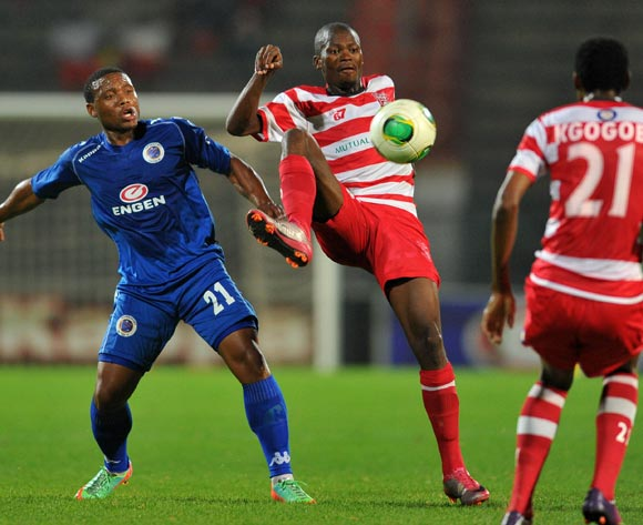 Osego Gaotewe of Gaborone United challenged by Thuso Phala of Supersport United during the CAF Confederations Cup match between Supersport United and Gaborone United at Lucas Moripe Stadium in Atteridgeville on the 08 February 2014