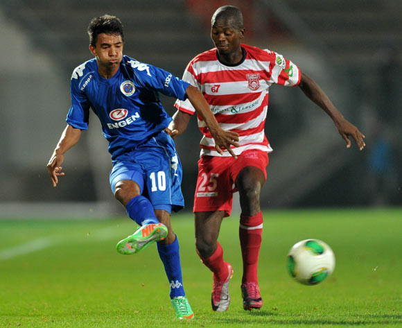 Doutie Sameehg of Supersport United challenged by Osego gaotewe of Gaborone United during the CAF Confederations Cup match between Supersport United and Gaborone United at Lucas Moripe Stadium in Atteridgeville on the 08 February 2014