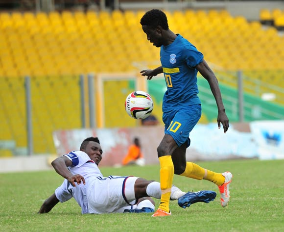 Alfred Nelson of Liberty Professionals challenging Samuel Boateng of Wa All Stars During the Premier League ©Christian Thompson/BackpagePix