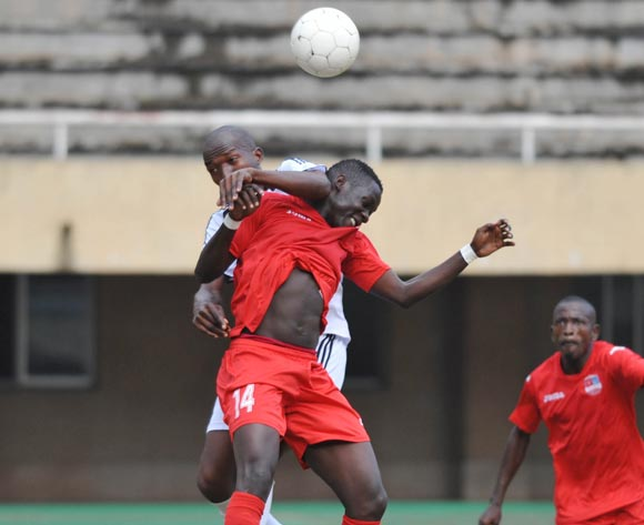 Simon Okwi of Victoria University heads the ball as he is fouled by David Senabulya of Masaka Locoal Council  during the 2013 Fufa Super League game between Victoria University v Masaka Local Council at Mandela Stadium, Namboole, Kampala on 30 August 2013