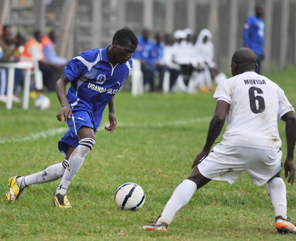 Michael Katosi (L) of Police FC being challenged by Yusuf Mukisa (R) of Proline FC during their 2013 Fufa Super League game at Lugogo Stadium, Kampala on 10 September 2013 ©Ismail Kezaala/BackpagePix